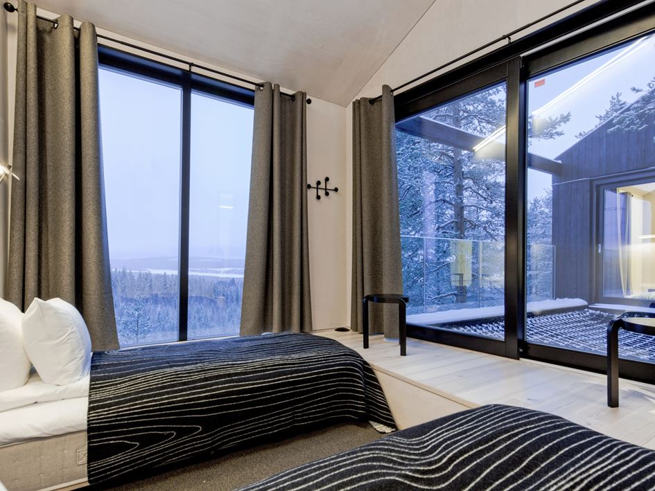 Stay at This Comfortable TreeHotel Bedroom with Great View to the Beautiful Nature