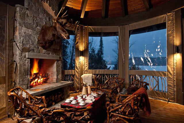 dining beside stone fireplace view ot lake placid