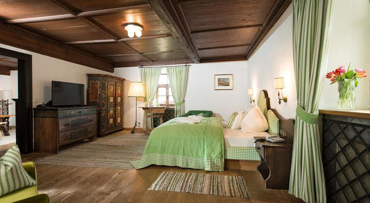 green stylish rustic bedroom hotel in austrian castle
