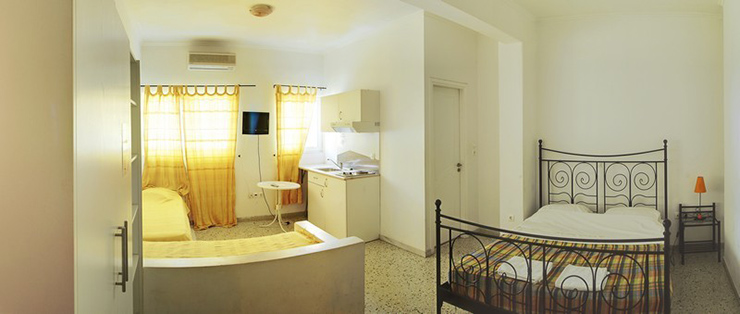 visit athens hostel with double iron bed