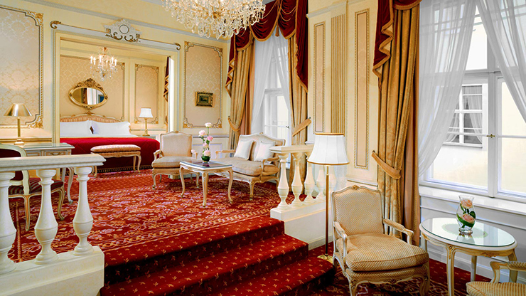 red flooring gold walls maria theresia suite vienna
