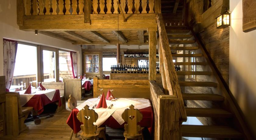 rustic style restaurant with terrace in italian alps