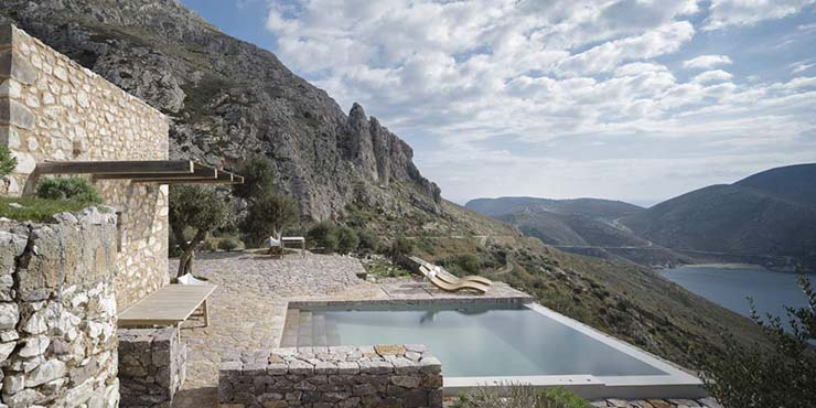 tainaron blue retreat greek ancient tower hotel infinity pool clifftops