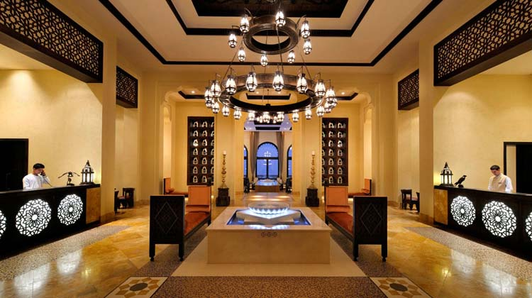 reception desk and part of qasr al sarab lobby with majestic oriental