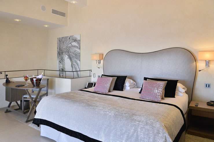 lovely suite king size bed pink pillows hotel in nice