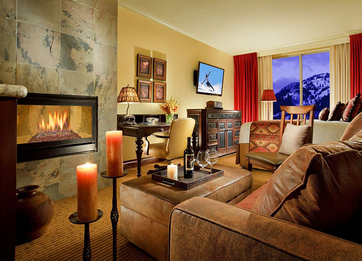luxury guestroom with fireplace rustic style