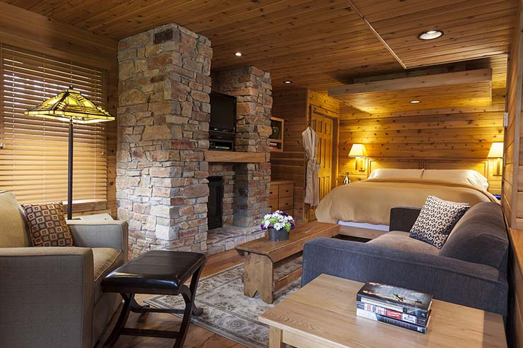 wooden style interior and stone fireplace for more comfort