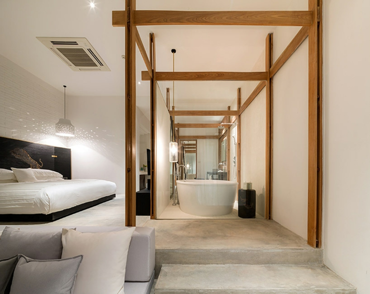 Concrete Floor Transparent Wall Bathroom And Cozy Double Bed