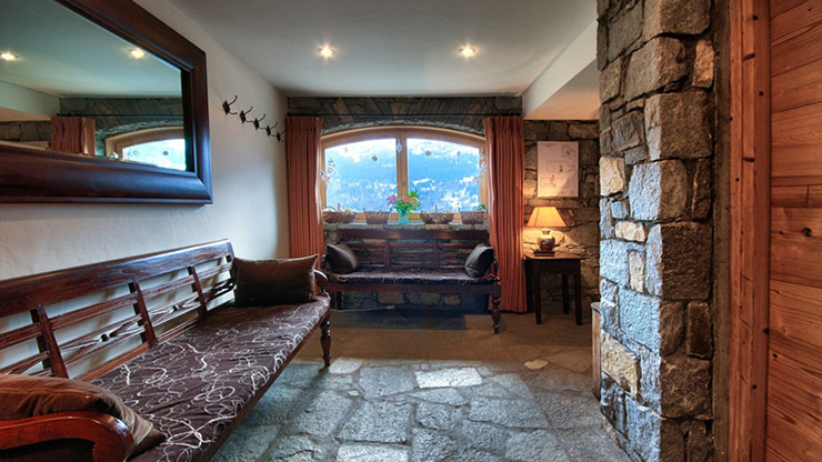 chalet room wood stone bench luxury holiday
