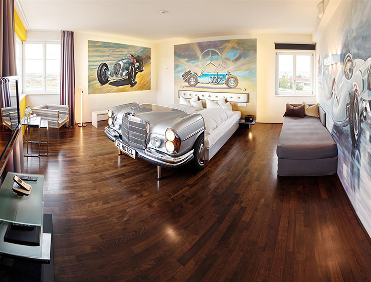 the v8 hotel a unique experience for car lovers. Black Bedroom Furniture Sets. Home Design Ideas