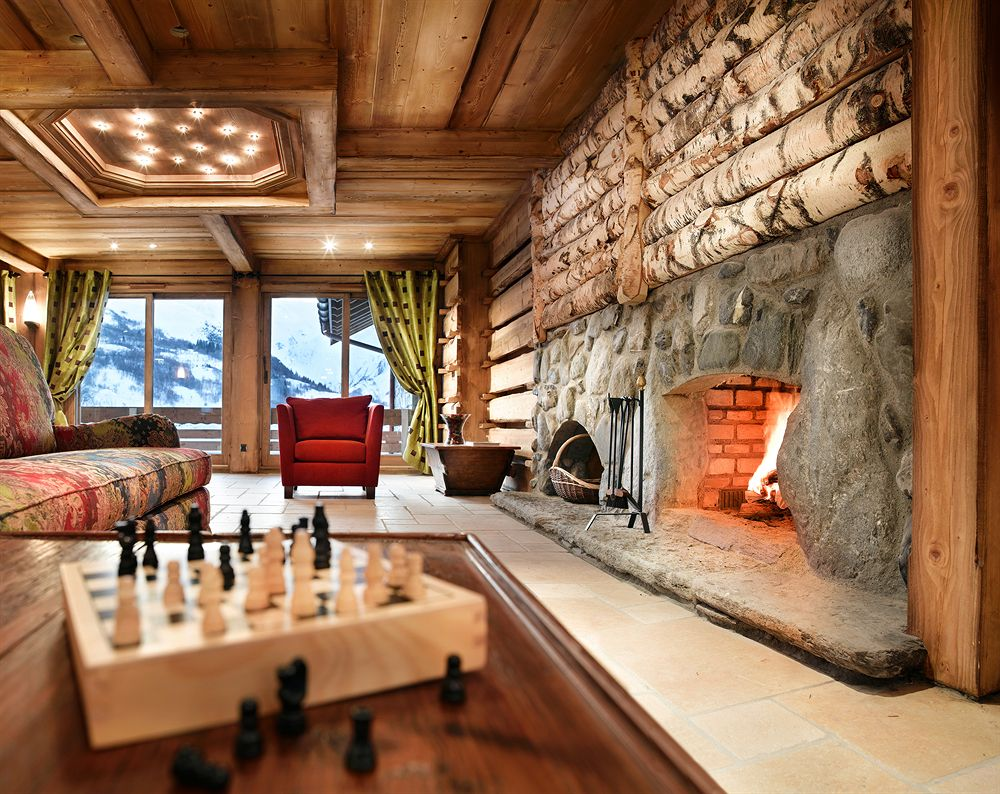 living room suite hotel alps fireplace