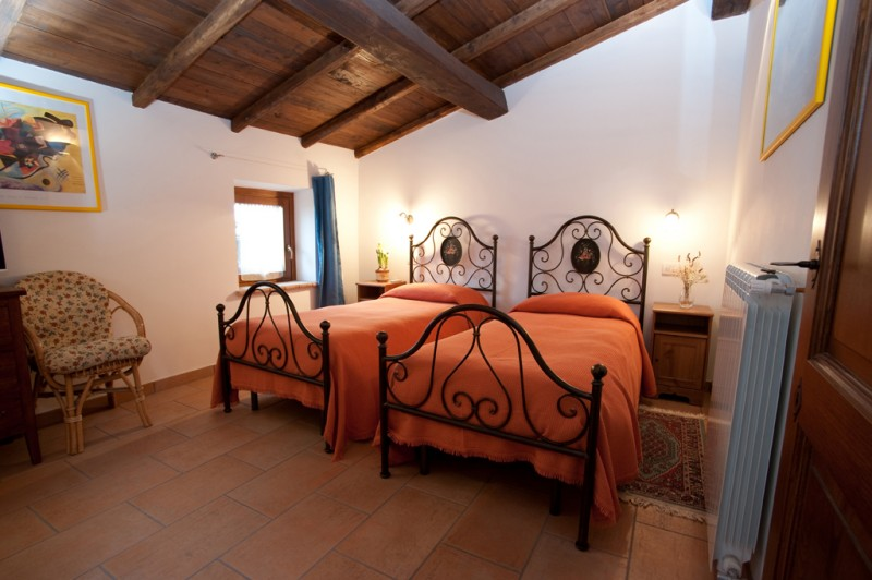 Or Book Accommodation in Rustic Style Room with Wrought Iron Beds