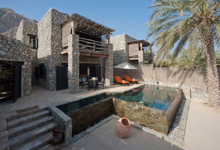 luxury six sense resort pool villa stone walls