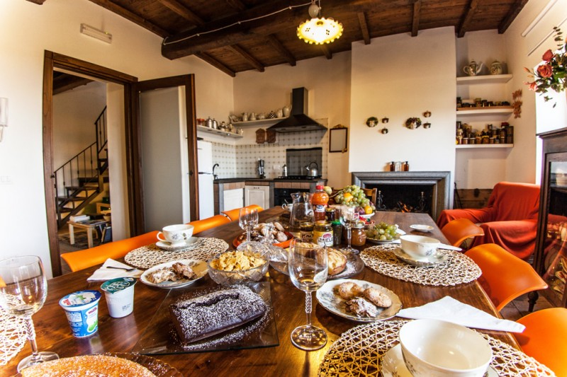 A Spacious Breakfast Room with Fireplace is Available also for Resting and Relaxing