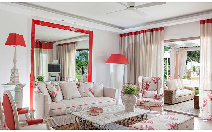 nice red stylish living room part of luxury villa for rental in corfu, greece