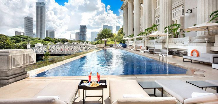 The fullerton hotel singapore for Hotel with swimming pool on roof singapore