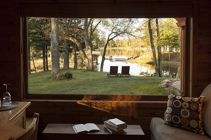 lake view through the window of luxury cottage
