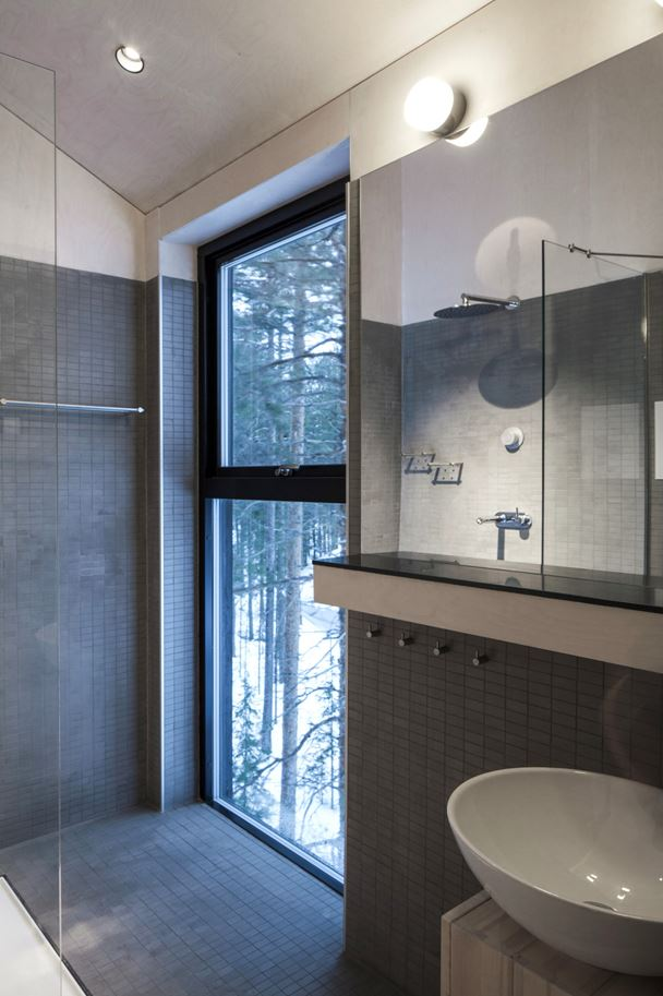 TreeHotel 7th Room Offers Modern Amenities such as Cozy Bathroom and Sauna