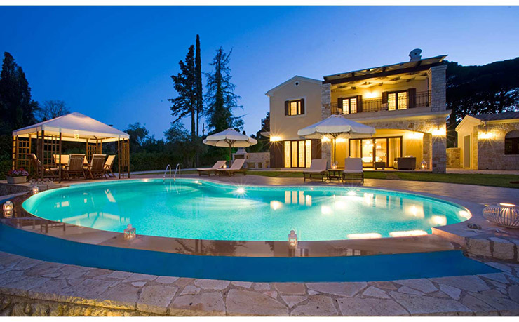 Mansion with pool at night  S and O Villas Corfu, Greece