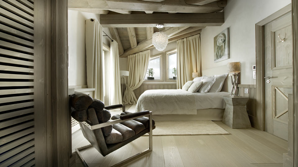 luxury white pearl chalet bedroom in french alps