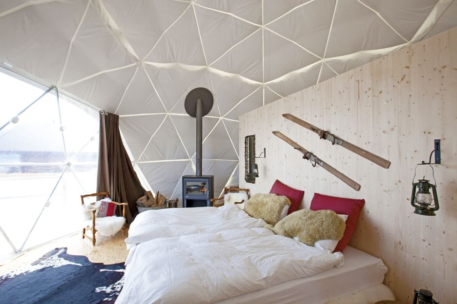 Book Accommodation in this Cozy Rustic Style Tent at White Pod Swiss Alps Resort
