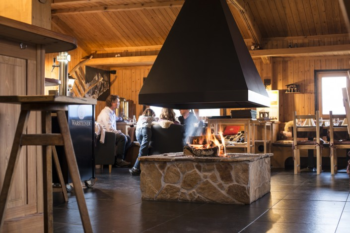 Get Warm and Socialize with other Guest around this big Open Fireplace at Resort Chalet