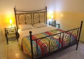 iron framed bed large comfortable room hostel athens