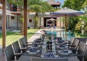 dinner table beside pool luxury villa bali