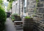 green garden bench table castle rock hostel