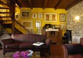 stone walls covered with art greek hotel