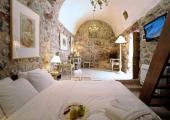stone walls deluxe guestroom greece hotel