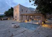 luxury hotel greece terrace with pond and dining area