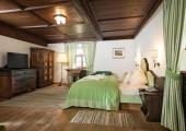green stylish rustic bedroom hotel in austrian castle