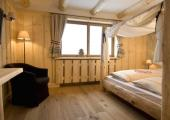 Book an Accommodation in a Rustic Hotel in Dolomites