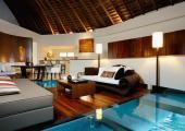 transparent floor exotic villa in turquoise water