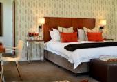yellow bedroom red pillows luxury hotel peech
