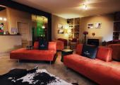 red sofas yellow walls peech hotel loby area