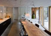 rustic style dining area at swiss alps villa vals