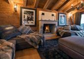 ski holiday swiss chalet rental living area fireplace