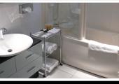 luxury white decorated bathroom with bathtub