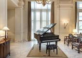 presidential suite living area with piano