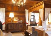 hotel castle rustuc desing guestroom wooden antique bed