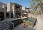 luxury six sense resort pool villa stone walls