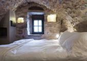 master suite bedroom greek rustic hotel