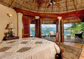 Exotic thatched roof and fan interior suite