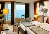 yellow warm decorated guestroom hotel marriorr cannes