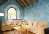 living room with sky blue walls and comfort sofa