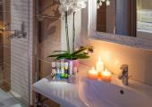 bathroom with candles in luxury greece villa for rental