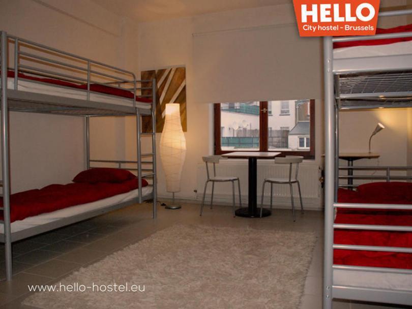 red linens bunk bed dorm brussels hello hostel