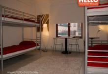 red linens bunk bed dorm brussels hello hostel
